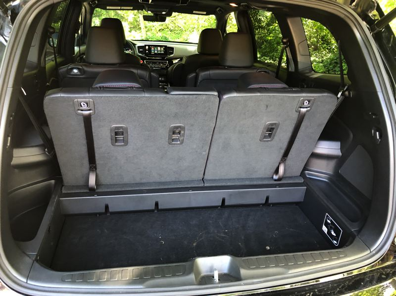 PMG PHOTO: JEFF ZURSCHMEIDE - The third row also folds down easily, creating a large cargo area in the 2020 Volkswagen  Pilot.
