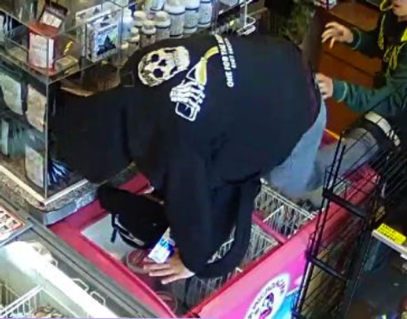 COURTESY PHOTO: GRESHAM POLICE DEPARTMENT - Security footage showed a man steal from Good Neighbor Market, punch employee.