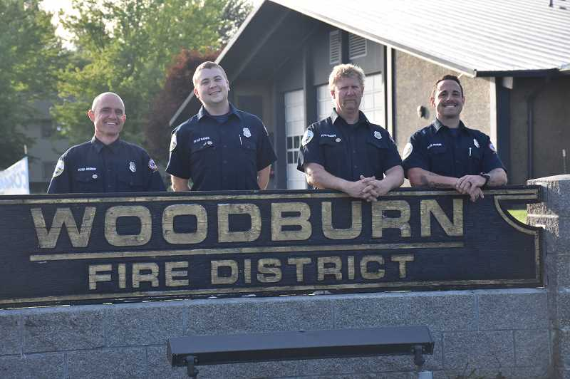COURTESY OF WOODBURN FIRE DISTRICT - Woodburn Fire Fighters, left to right, Ryan Johnson, Mitchell Raines, Robb Gramzow and Jesse Halpern. Johnson and Raines are completing paramedic training, joining Gramzow, Halpern and Jon Koenig on the districts advanced life support unit.