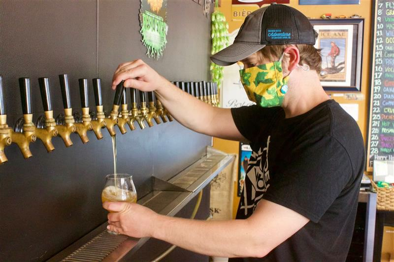 PMG PHOTO: CHRIS KEIZUR - The barkeep pours a cold one at Gresham's Hoppy Brewer Friday.