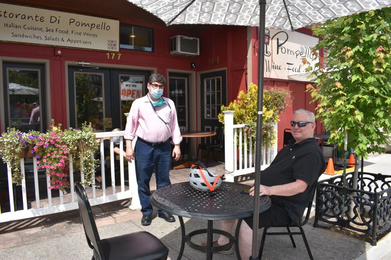 PMG PHOTO: TERESA CARSON - Saul Pompeyo chats with regular customer Brian Emett on the first day the popular restaurant could serve customers in person after the pandemic hiatus.