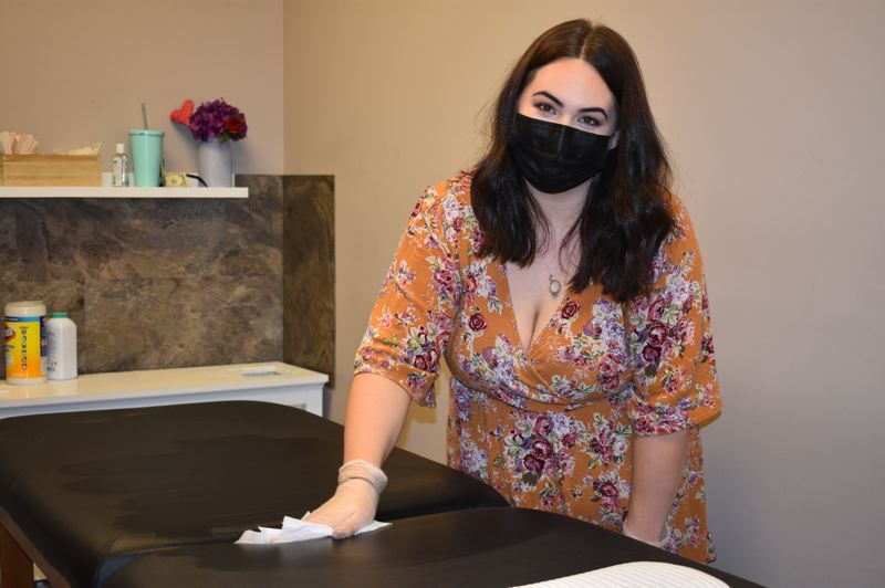 PMG PHOTO: TERESA CARSON - Alivia Miller, owner of Wink & Wax in Gresham is meticulous about cleaning between each client at her salon, which does eyelash extensions, waxing and facials.