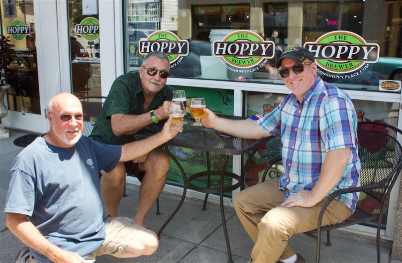 PMG PHOTO: CHRISTOPHER KEIZUR - Steve Kraus, right, owner of Hoppy Brewer and some regulars toast to everyones good health.