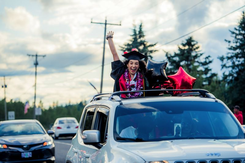 COURTESY PHOTOS: KAREN HAWLEY - Valedictorian Mya Peterson celebrates her graduation in the parade from Troutdale to the Corbett School District campus for the big event.