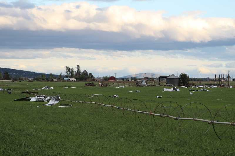 TONY AHERN/MADRAS PIONEER - Gov. Kate Brown is asking the U.S. Department of Agriculture to assist victims of the storm that caused massive damage in Culver and Metolius May 30.