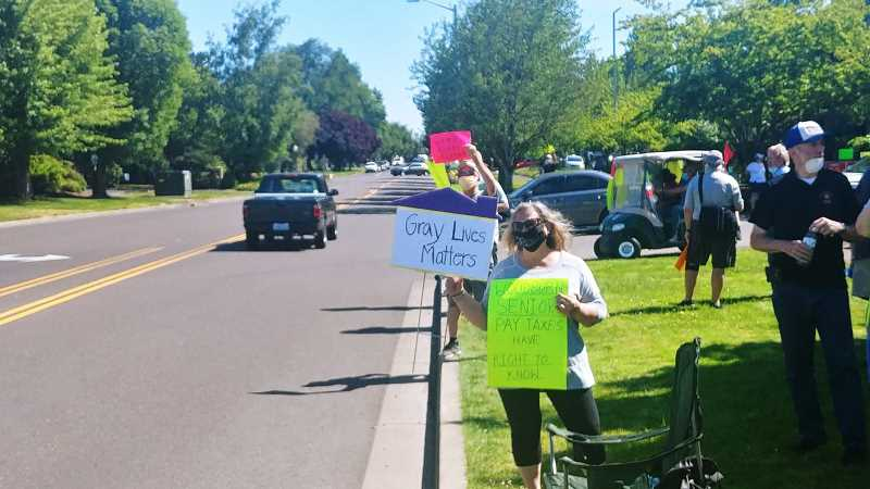 PMG FILE: PHIL HAWKINS - People gather near Super 8 Motel in Woodburn on Thursday, Jume 25, to protest Marion Countys plans for a COVID-19 isolation facility at the site.