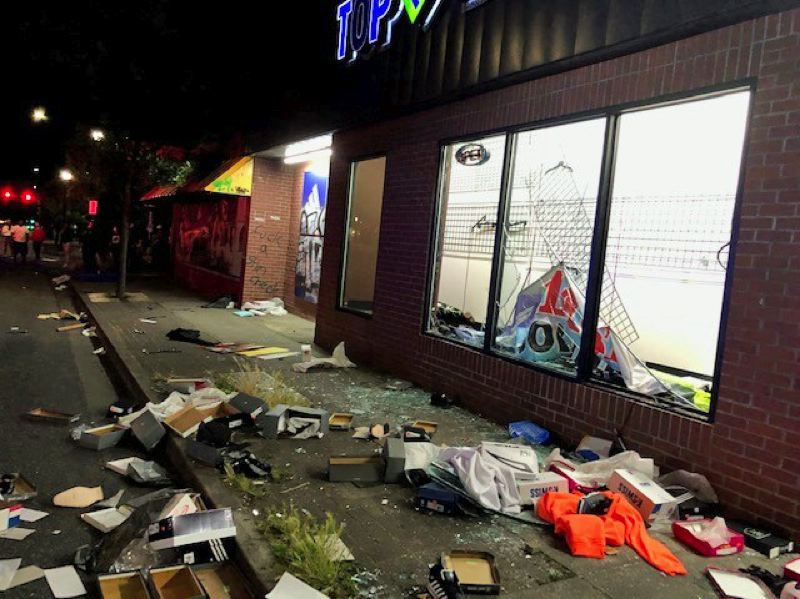 COURTESY PHOTO: PPB - A store near the Portland Police Bureau North Precinct was trashed by looters Thursday night.
