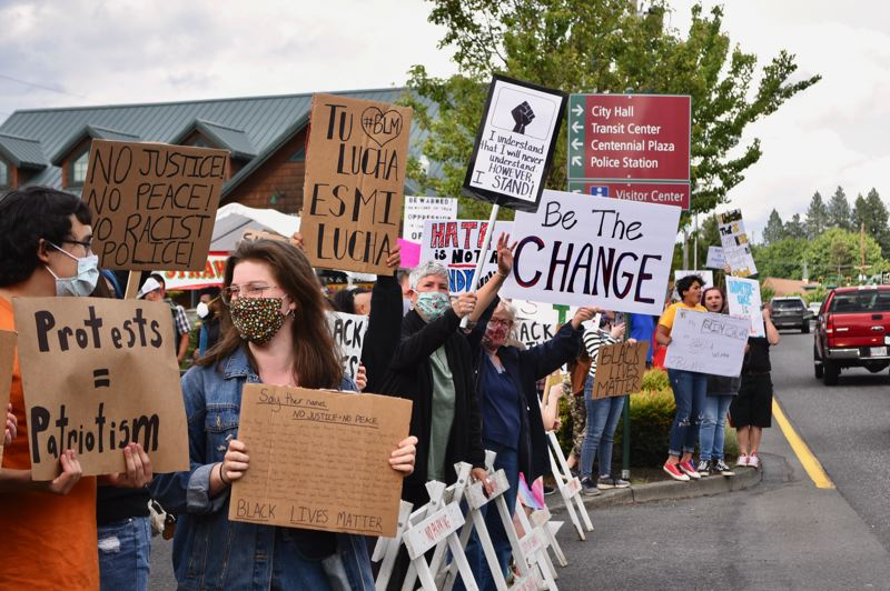 PMG FILE PHOTO - Several of the people who came out to the first March Against Racism in Sandy were local students.
