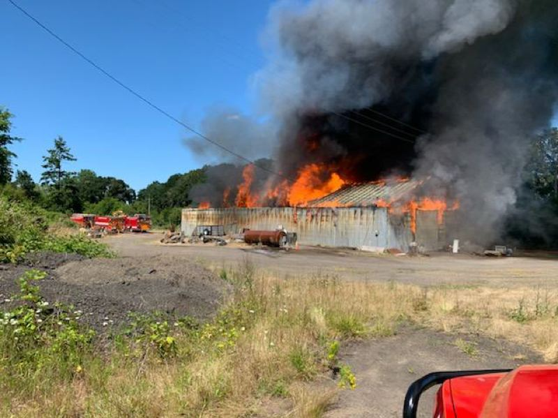 COURTESY PHOTO: TUALATIN VALLEY FIRE & RESCUE - A barn burns near Southwest Burkhalter Road in rural Hillsboro on Friday, June 26.
