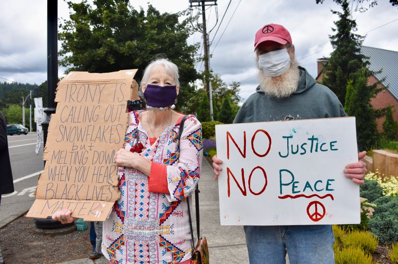 PMG PHOTO: EMILY LINDSTRAND - Estacada community members hold signs in support of Black lives matter, justice and peace.
