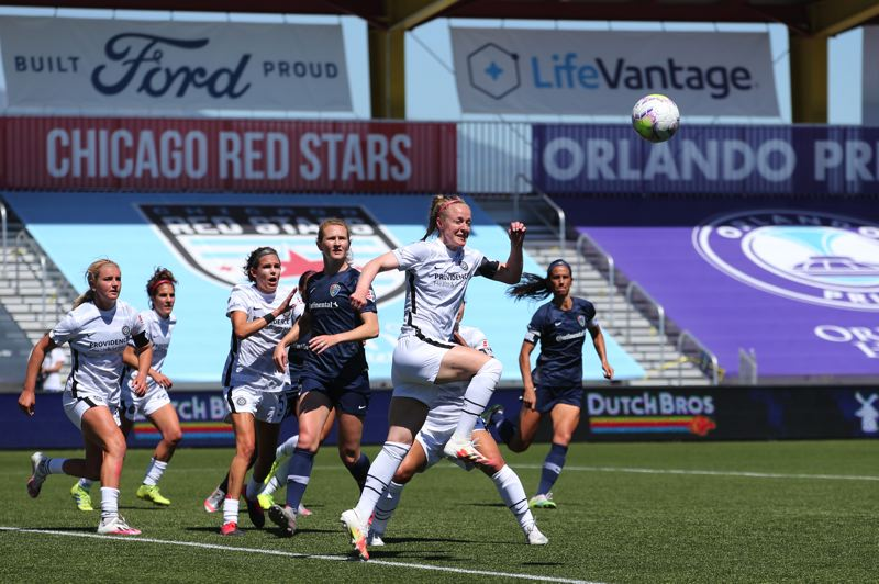 COURTESY PHOTO: ROB GRAY/ISI PHOTOS - Portland Thorns defender Becky Sauerbrunn jumps to play the ball during the first match of the National Women's Soccer League Challenge Cup on June 27. North Carolina beat Portland, 2-1.