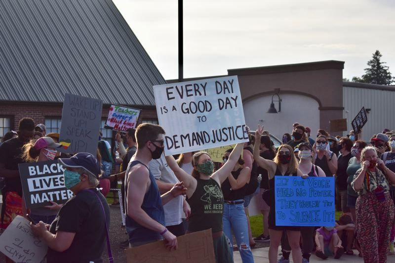 PMG PHOTO: EMILY LINDSTRAND - Participants in Estacada's march against racism on Friday, June 26, gather at Estacada City Hall.