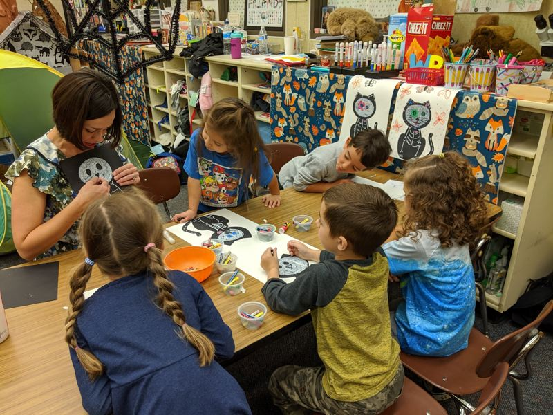 PMG FILE PHOTO - Children in an elementary school classroom work on art projects in 2019.
