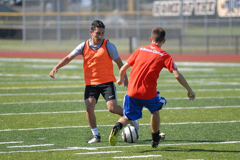 PMG FILE PHOTO: DEREK WILEY - Canby soccer athletes scrimmage in August 2019.