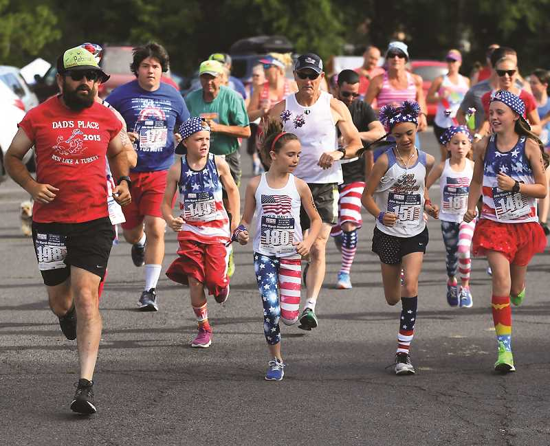 CENTRAL OREGONIAN - Runners take off during the John Marsh Memorial Run last July 4th. While much of the Splash 'N Dash will be virtual in 2020, the Marsh run will be a live event. There will also be a virtual option for the Marsh run.