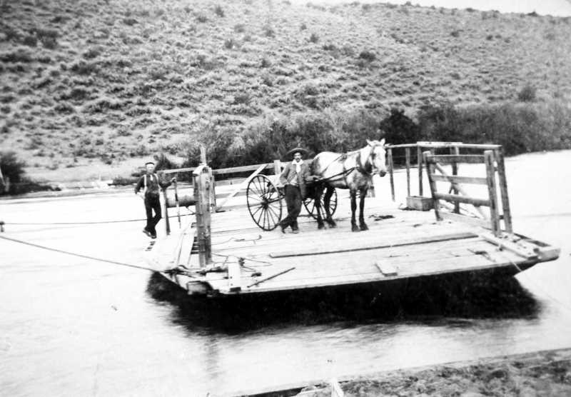 PHOTO COURTESY OF BOWMAN MUSEUM  - The Campbell Ferry takes a couple men and their horsedrawn transportation across the Deschutes river back in 1900.
