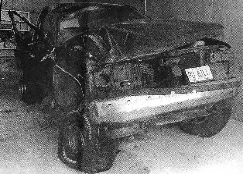 CENTRAL OREGONIAN - JUNE 22, 1995: Despite the message on the personalized license plate, only one of the five occupants of this vehicle was seriously injured following the rollover.