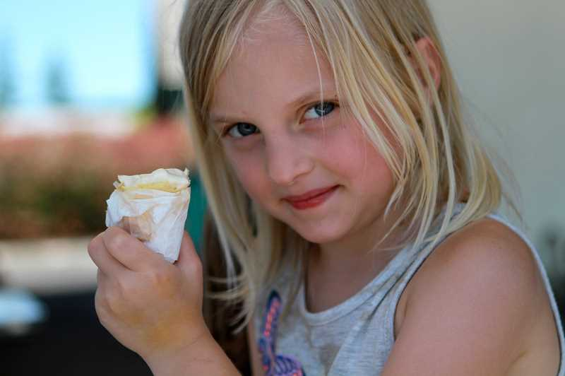 PMG PHOTO: MILES VANCE - St. Helens Samantha Zuschlhe, 6, joined her family for ice cream at the Dari Delish on Friday, June 26.