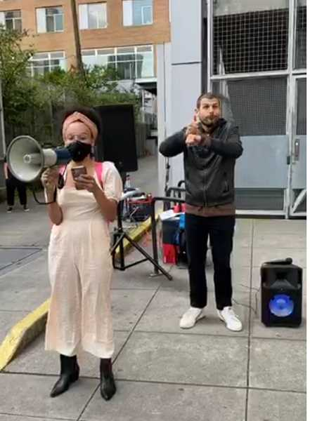 SCREENSHOT- FACEBOOK LIVE - An organizer and activist with Disarm PSU leads a vigil for Jason Washington on June 29, 2020, two years after his death. To the right, a sign language interpreter translates speeches and announcements.