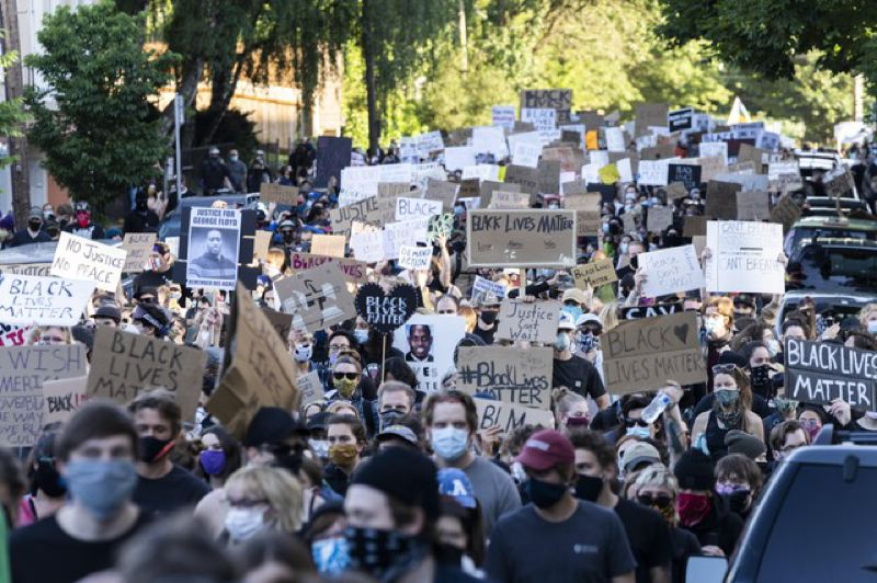 JONATHAN LEVINSON/OPB - Massive crowds gathered in Portland on June 1 for protests over the killing of George Floyd, a Black man from Minneapolis who was killed after a police officer pushed his knee into his neck for nearly nine minutes.