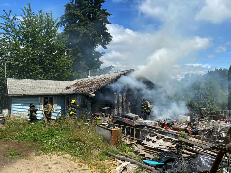 COURTESY PHOTO: FOREST GROVE FIRE & RESCUE - Firefighters on the scene of a residential fire that destroyed a home in rural Gaston on Tuesday, June 30.