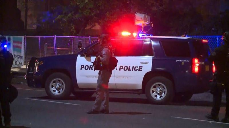 KOIN 6 NEWS -  Portland police outside the Justice Center on June 22,