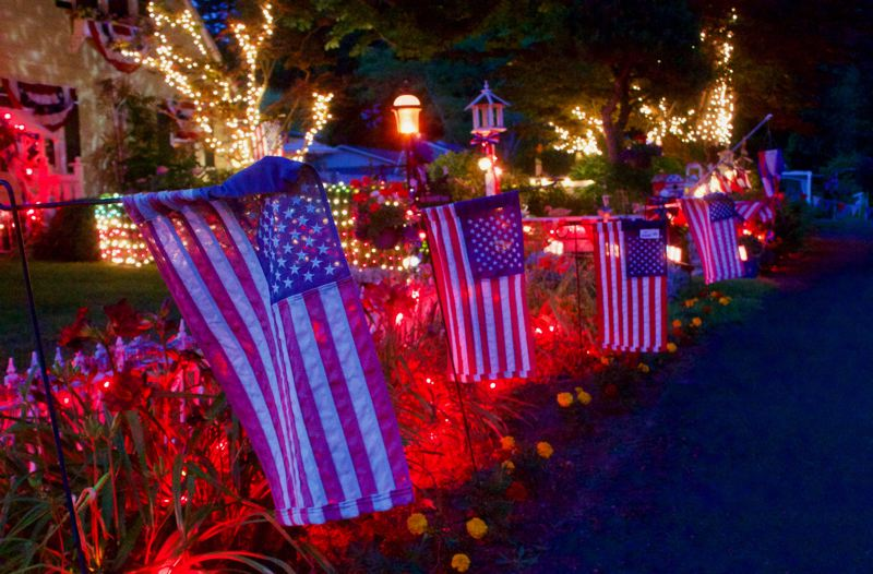 PMG PHOTO: CHRISTOPHER KEIZUR - Three families have decorated Liberty Lane to celebrate the 4th of July as other events have been canceled.