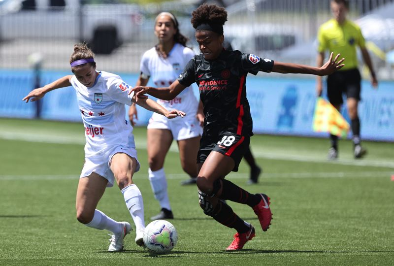 COURTESY PHOTO: BRYAN BYERLY/ISI PHOTOS - Portland Thorns defender Simone Charley (38) tries to elude a Chicago defender during Wednesday's scoreless draw at the NWSL Challenge Cup in Herriman, Utah.