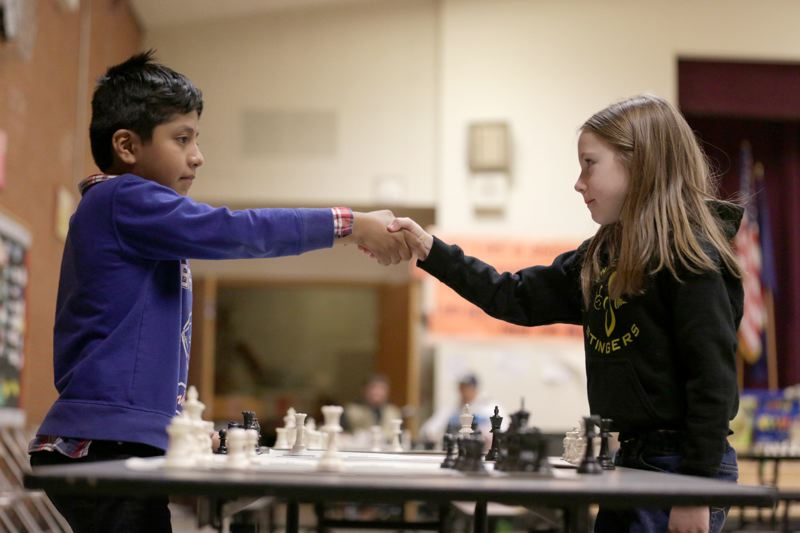 PMG FILE PHOTO - Bertin Toscano Martinez shakes hands with Erin Reaney after her 2015 win, during the Chess for Success regional tournament.