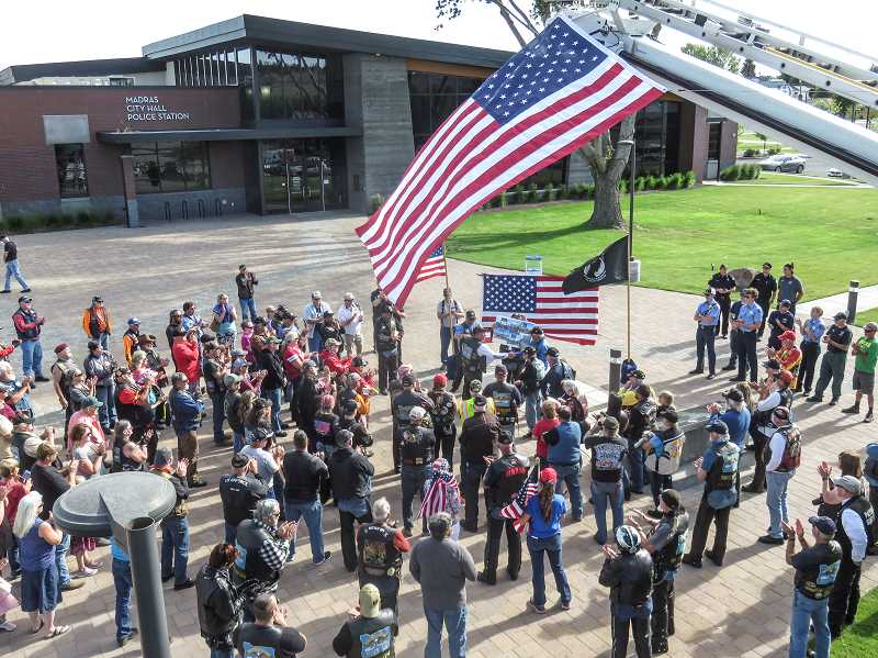 TOM BROWN/FOR THE PIONEER - The Oregon Veterans Motorcycle Association made a stop in Madras Saturday, June, 27, to dedicate a memorial sign in honor of prisoners of war and troops missing in action.