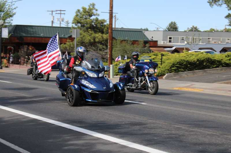 TERESA JACKSON/MADRAS PIONEER - Participants in the memorial ride head to thememorial plaza at Madras City Hall.