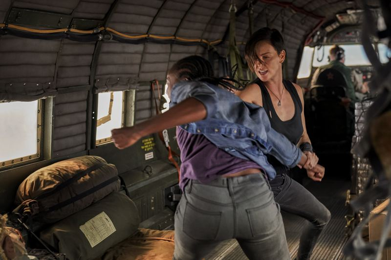 COURTESY PHOTO: AIMEE SPINKS/NETFLIX - Although comrades later, the characters of Charlize Theron and KiKi Layne engage in an early fight in 'The Old Guard.'