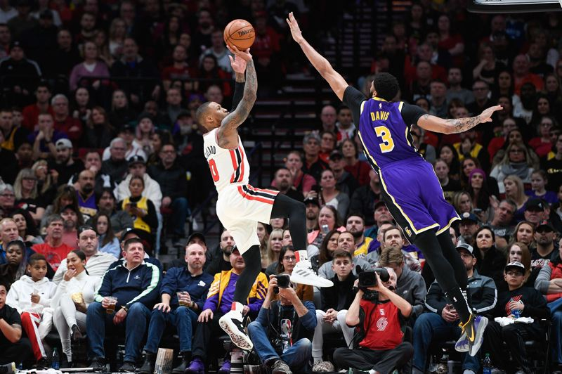 PMG FILE PHOTO: CHRISTOPHER OERTELL - Damian Lillard, shooting over the Lakers' Anthony Davis, is optimistic about the Blazers' chances in the NBA restart, given that all teams in Orlando will be 'rusty.'