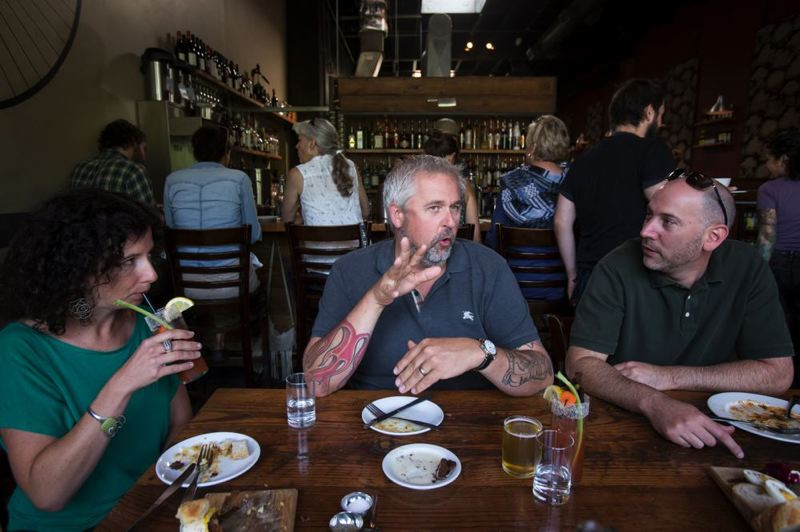 PMG; JONATHAN HOUSE - In better times (2014) Chef/owner of Toro Bravo and Tasty n' Sons John Gorham holding court during brunch. The restaurant group is closing.