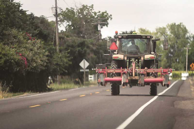 PMG FILE PHOTO - As the area's harvest season unfolds, more and more slow-moving vehicles will be out on the roads.