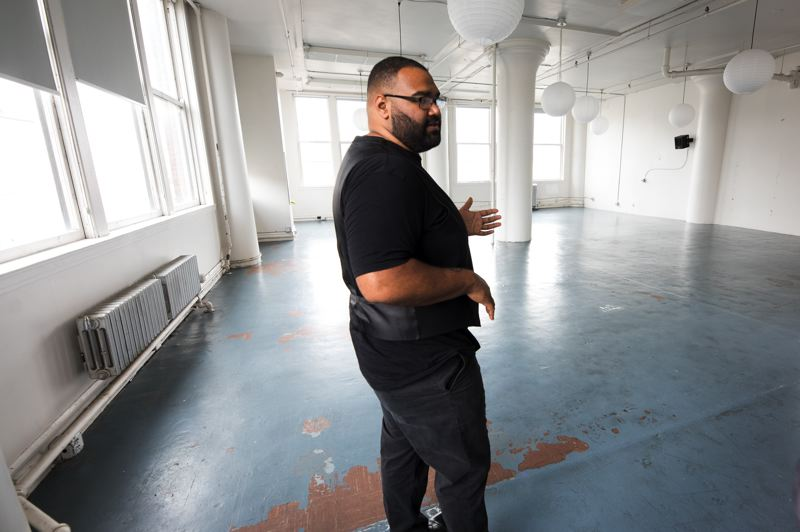 PAMPLIN MEDIA GROUP: JAIME VALDEZ - Photographer Jacobsen Valentine in the Portland Storage Building. He is opening a shared work space for BIPOC people of color digital creatives on July 6. It is intended to be a safe space. Valentine prefers concrete actions, such as feeding the hungry and offering subsidized office space, to talk and posturing.