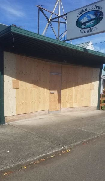 COURTESY PHOTO - Clackamas River Growlers remained open but boarded up their storefront as a precaution during a recent march against racism.