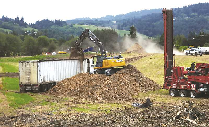 PMG PHOTO: GARY ALLEN - Crews continue to clear a 32-acre parcel adjacent to Highway 99W in preparation for construction of a large housing and commercial complex.