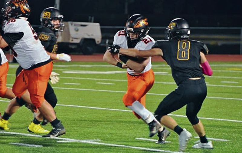 PMG FILE PHOTO - The Oregon School Activities Association, National Federation of State High School Associations and the state of Oregon are still considering whether high school sports - here Scappoose's Deacon Smith tries to get away from St. Helens' Adam Stockwell in 2019 - can resume in the fall.