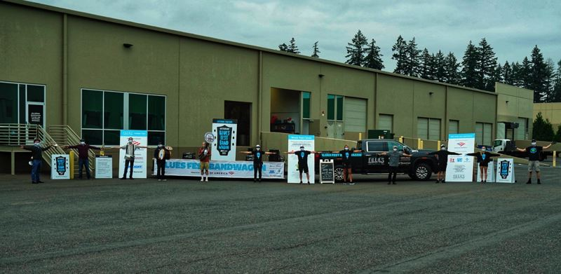 COURTESY PHOTO: NORM EDER - On the move to Friday's first location, starting from a storage facility in Tualatin. The crew feeling the social-distanced blues include, from left, Tracey Walker, Tyler Fuller, Christina Fuller, Peter Dammann, Isaac Perlmutter, Jessie Smith and Wes Yurovchak
