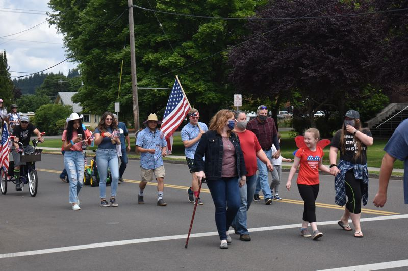 PMG PHOTO: EMILY LINDSTRAND - The Estacada Patriotic March makes its way down Main Street on Saturday, July 4.