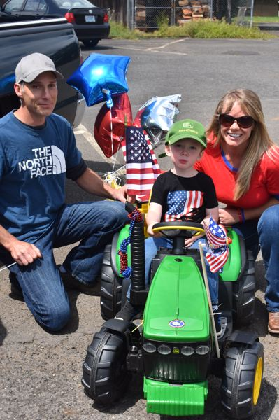 PMG PHOTO: EMILY LINDSTRAND - Bryson, Jaxson and Shelby Smith were some of the participants in Estacada's Patriotic March.