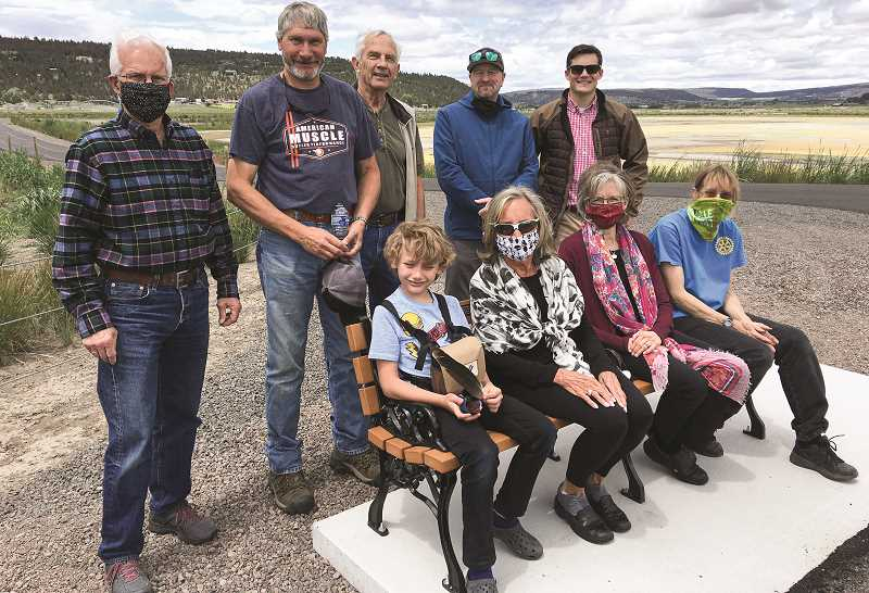 PHOTO SUBMITTED BY GARY GOODMAN - Crook County Rotarians and members of Crook County On The Move celebrate the completion of 10 park benches at the Wetlands. The benches are spaced 300 feet apart around two loops to encourage people to explore the area. Pictured back row, left to right, are Prineville Mayor Steve Uffelman, Ken Fahlgren, Bill Zelenka, Todd Flack and Oliver Wisseman. Pictured front row, left to right, are Wyatt Fahlgren, Sally Goodman, Donna Barnes and project manager Carol Benkosky.