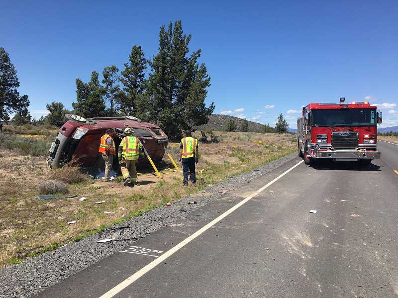Two injured in rollover crash