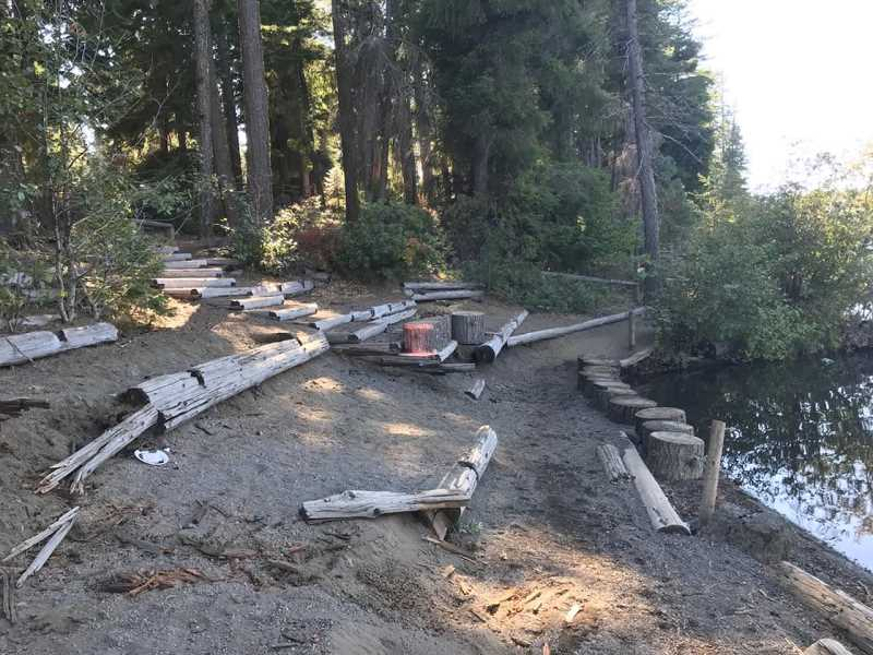 SUBMITTED PHOTO - In 2019, rotten and failing logs used as trail structures around the Suttle Lake Trail were removed and replaced with rock as part of a U.S. Forest Service project to improve erosion control. Now some tree removal is planned.