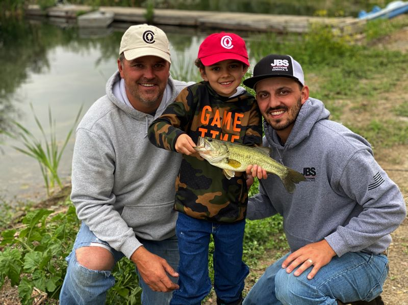 COURTESY PHOTO: LUKE OVGAD - J.B. Salutregui (left) poses with his grandson Jex (middle) and son Jace after Jex caught, handled and released his first bass all by himself.