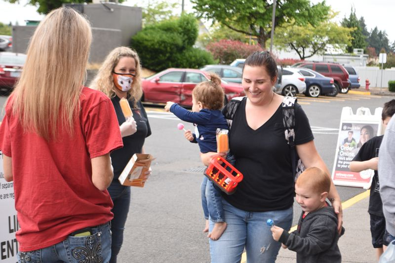 PMG PHOTO: BRITTANY ALLEN - Youths and the young at heart benefitted from Heldstabs sweet treats on July 2.