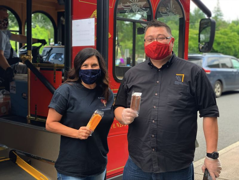 COURTESY PHOTO - Machel Heldstab and Clackamas County Bank Marketing Specialist Brian York hand out popsicles at Safeway.