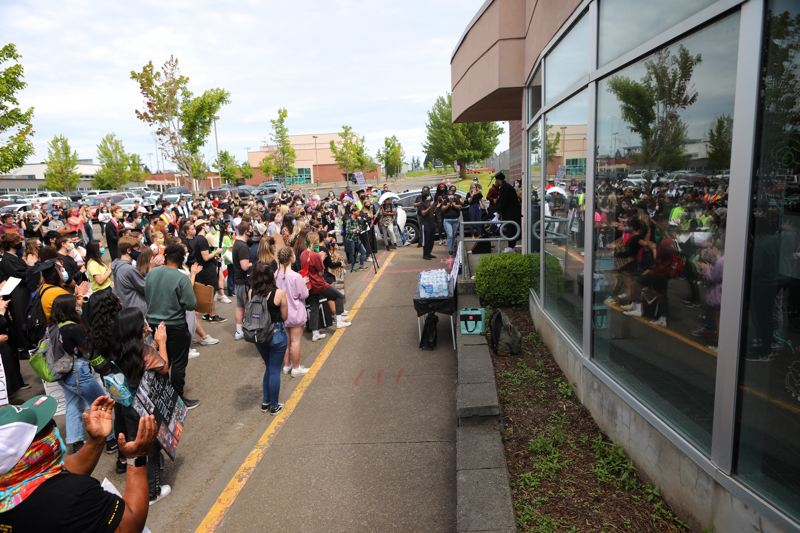 PMG PHOTO: JAIME VALDEZ - Students and the general public gathered in the southern parking lot at Tualatin High School earlier this year.