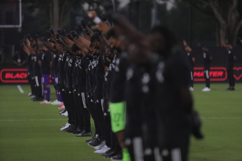 COURTESY PHOTO: MAJOR LEAGUE SOCCER - More than 100 Black MLS players participated in a demontration in support of racial justice prior to Wednesday's opening match of the MLS is Back Tournament near Orlando, Florida.